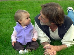 Baby and father on lawn